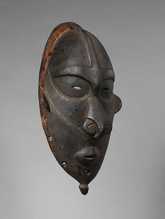 Mask. Papua New Guinea late 19th-early 20th century. Wogeo or Bam peoples. The peoples of the Schouten Islands, an offshore archipelago near the mouth of the Sepik River, create distinctive masks representing spirits called village lewa. Masked performers impersonating those spirits appear to dance and enforce a ban on harvesting coconuts during the lead up to walage, ceremonial food distributions held by the village headman