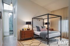 Vintage McGuire nightstands and a pair of 1970s-inspired Arteriors lamps flank a bed from Room & Board in this Portland home's master bedroom.   See more: http://luxeworthy.luxesource.com/slideshow/213/inside-one-couples-1950s-hillside-portland-ho/5