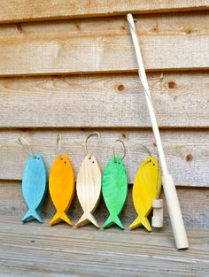 Handmade Waldorf inspired wooden fishing set including 5 wooden fish and fishing pole. The fish are made of poplar wood and the fishing pole is made of birch. The hooks on each fish are made of hemp twine as is the the fishing line. All knots are sealed using a non-toxic, child safe glue. The paint is also non-toxic and child safe. All of the wood is sealed with food grade, child safe wood sealer.  This is truly a favorite of our 2 year old daughter, Brynn. Great for developing fine motor…