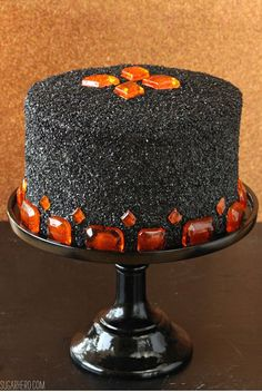 This dark devil's food cake with pumpkin butterscotch frosting uses three different types of cocoa for the richest cake yet.