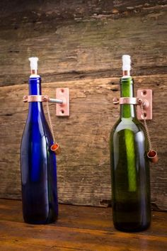 Wine Bottle Tiki Torch | Great Bottles of Fire | Bourbon & Boots.........  Site has some really cool gifts ..many you can DIY!