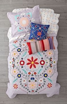 Shop Baja Garden Bedding.  This lavender floral kids bedding is far from garden-variety.  The quilt and sham are adorned with lush flower embroidery.  Coordinate it with our Baja Garden Throw Pillows for a kids bedroom that's in full bloom.