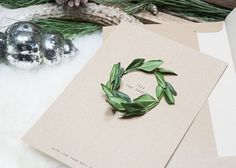 These elegant and inexpensive wreath cards. | 23 DIY Christmas Cards You Can Make In Under An Hour
