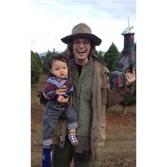 Love him but whyyyy is he holding a baby AND a construction tool lolol