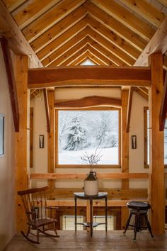 Exposed pine rafters and curving cherry beams are the structural finish work.