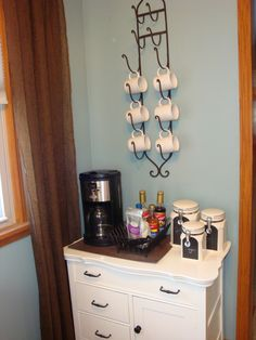A DIY coffee bar. The wine rack doubles as a holder for mugs! Genius!