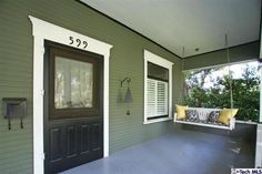 Love the Black door and porch swing..
