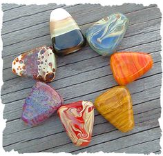 Falling Autumn!  Here's a new organic set of Artisan Boro Glass Lampwork Beads my hubby made. Shaped like candy corns or arrows.  Available on our website: www.javabead.com