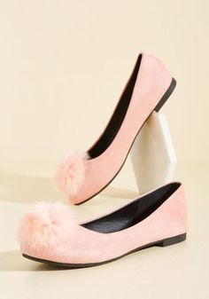 You can't help but bounce around the block in these pink flats - they always raise your spirits! Designed with sweet rounded toes topped with fluffy faux-fur pom-poms, this rosy, faux-leather pair keeps your step quite sprightly.