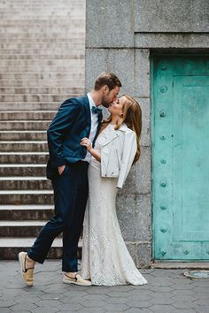 Bride in Lace Watters Wedding Dress with Leather Jacket | Brides.com