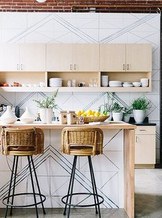 Those chairs though Love this geometric-inspired modern kitchen, designed by Allison Bloom Design of Decorist, and photographed by John Merkl. Home Decor Kitchen, Home Kitchens, Kitchen Dining, Coastal Kitchens, Modern Kitchens, Kitchen Tile, Kitchen Island, Home Interior, Kitchen Interior