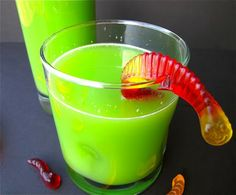 -Newt Juice-- Lime jello is dissolved in hot water before being mixed with pineapple juice, orange juice concentrate and lastly a splash of ginger ale. Yellow and blue food coloring assure the perfect color. Garnish with gummie worms!