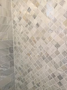 Carrara marble Arabesque shower tiles                                                                                                                                                                                 More