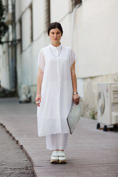 "I like the dress, not a fan of the pants or shoes, but she doesn't look bad.    Photo taken from ""The Sartorialist"""