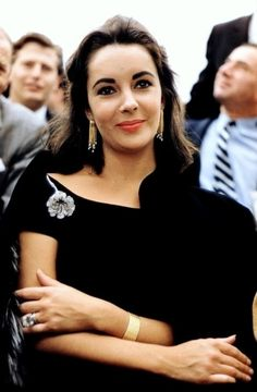 Classic beauty: Elizabeth Taylor's rich, deep Dark Brown haircolor always made a statement. Find your own best #DIY #hair #color to cover gray hair at home here: http://www.haircolorforwomen.com/breakthrough-hair-color-system-your-salon-doesnt-want-you-to-know-about-p/