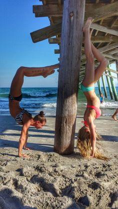 Playing around at emerald isle with my lil sis ♡ beach yoga. Yoga teachers. Yogaeverydamnwhere. Handstands. IG: @pamela.riniryt