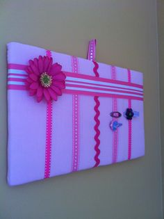 My hair clip storage board! - So doing this I put abigail's clips on ribbon last weekend and was going to do the mount to a wood plaque but like this even better since they can't slip off. :o)