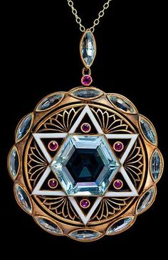 Art Deco Star of David Aquamarine Pendant. An original pre World War II Art Deco pendant designed as a round openwork matte gold plaque with a white enamel six pointed Star of David set with a hexagonal aquamarine and six small rubies. The star is flanked Ruby Jewelry, Art Deco Jewelry, Jewelry Design, Jewellery, Jewelry Necklaces, Aquamarine Pendant, Gold Pendant, Antique Jewelry, Vintage Jewelry