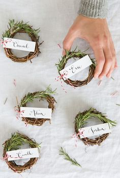 DIY rosemary wreaths for a woodland wedding place card. Cute and tedious idea that would be fun to put together with your bridesmaids!