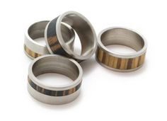 I'd start wearing a ring if I got my hands on one of these stainless steel and inlaid wood rings by TIVI.  They're extremely affordable for only $25!
