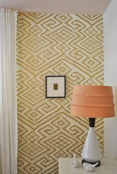 Moroccan-inspired wallpaper in an eclectic nursery- so chic!