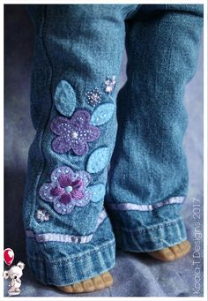 Listing includes one pair of denim boot cut jeans. With working front and back pockets. Pants have an elastic waist for easy pulling on and off. Hand sewn by Carly, using upcycled, washed, denim fabric. I am not affiliated with any Doll company. This outfit is professionally sewn with interior edges finished. Doll is not included. Fits 18 dolls like: My Life As, Our Generation, Journey Girls, Madame Alexander, American Girl, Newberry Dolls, Springfield Girls TollyTots