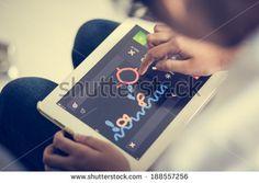 http://www.shutterstock.com/pic-188557256/stock-photo-hand-of-asian-girl-playing-tablet-fun.html?src=FHlC6Ti-yAtPmROzRyiSdA-1-33