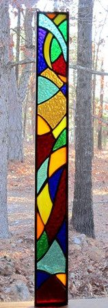 Stained glass window, very colorful..love the design. Dancing Glass.
