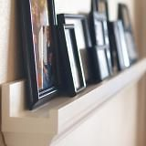 Simple gallery ledges that can transform a blank wall into an easy to display gallery. Gallery ledges are called $10 Ledges because each 8 foot long ledge is estimated to cost approximately $10 in lumber.