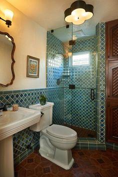 Mediterranean 3/4 Bathroom with Mexican tile, flush light, High ceiling, penny tile floors, Rain Shower Head, Pedestal Sink
