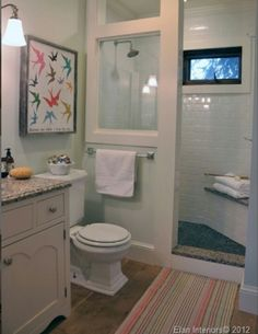 Walk in shower w/ corner bench for basement. Like the idea of using a reclaimed window in the shower as a shower half wall.