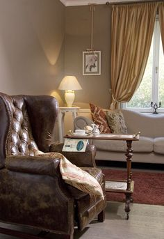 cosy livingroom! love the vintage armchair