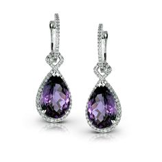 These fashionable 14k white gold earrings from our Vintage Vixen Collection hold .37ctw of white diamonds and hold a 5.64ctw Amethyst as the centerpiece.