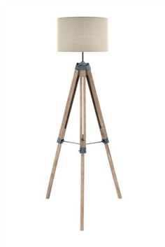 This Fun Lamp Features A Modern Wooden Tripod Base And