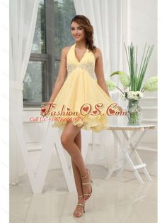 Halter Yellow Homecoming / Cocktail Dress With Appliques Mini-length Chiffon  http://www.fashionos.com  Whether you're attending a holiday cocktail party, black tie event, or going to prom, this halter top light yellow dress is the perfect choice. A flattering design looks great on all shapes with appliques and sparkle beadwork that add to the glamour. The mini length empire skirt has multi-layers adding beauty and interest to the dress.