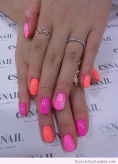 Amazing pink and orange nail art and nice rings