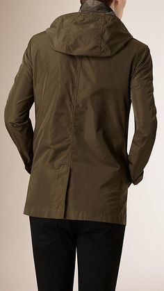 Burberry Khaki Technical Fabric Jacket with Detachable Warmer - A versatile jacket in a lightweight technical fabric. With clean lines, the straight-fit design features a single-breasted closure, detachable check wool-blend warmer and a detachable hood with drawcord detail. The jacket is finished with a tonal check under collar.  Discover the men's outerwear collection at Burberry.com