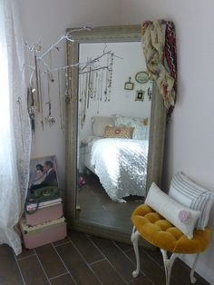 Eclectic Bedroom Design  Love the old mirror and the white branch used for jewelry storage.