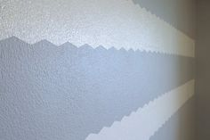 Painting chevron stripes on textured walls using #ShapeTape via @newlywoodwards