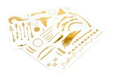 Would you wear metallic temporary tattoos? See our list of sources and why this is a conflicting trend!
