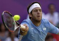 Spare a thought for poor, Del Potro.  Tough, tough loss.----Juan Martin del Potro of Argentina returns to Roger Federer of Switzerland at the All England Lawn Tennis Club in Wimbledon, London at the 2012 Summer Olympics, Friday, Aug. 3, 2012. (AP Photo/Elise Amendola)