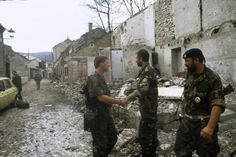 Yugoslav Civil War, 1993-95: Croat HVO soldiers greet each other after having forced the Serbs to evacuate Mostar, June 1992. The attack on the Serbian positions in the town was undertaken as a joint Bosnian - Croat operation.
