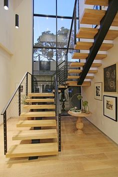 U shaped staircase design is good for big space,treads optiion:glass ,stone and wood. Staircase Railings, Staircase Design, Stairways, U Shaped Staircase, Floating Staircase, Hardwood Stairs, Steel Stairs, Wooden Steps, Industrial Stairs