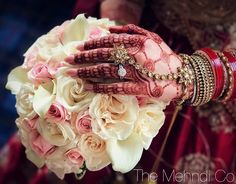 Indian bride's henna looking radiant as her bouquet plays a neutral background to bring out the gorgeous henna and jewelry. Bouquets consists of ivory roses, blush spray roses and white calla lilies Ivory Roses, Calla Lilies, Spray Roses, Bridal Bouquets, Big Day, Plays, Henna, Floral Design, Neutral