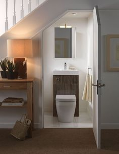 Interior , Creative Interior Design Under Stairs Ideas : Small Guest Bathroom Under The Stairs