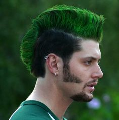omg hahaha   -  Jensen Ackles with a green mohawk and muttonchops. So weird but I love it. He'll always be Dean to me though.