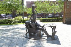 Dr Seuss National Memorial Sculpture Garden in Springfield, MA. Dr. Seuss and the Cat in the Hat: Theodor Geisel at his drawing board, with the Cat in the Hat at his side.