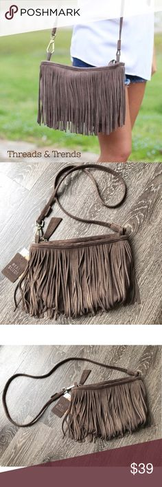 "Boho Suede Fringe Crossbody Bag Genuine Suede Boho Fringe crossbody bag. Zipper closer with 2 inside pockets. Strap drop 29"", width 12"", height 8"". Color difference in photos are do to indoor lighting and natural sunlight. Altar'd State Bags Crossbody Bags"