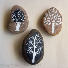 Simple trees painted on rocks
