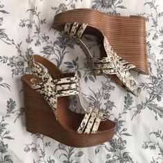 """Tory Burch Leslie Python Wedges These are perfect for spring and summer! Sold out everywhere and in the hard to find Python. These have been gently used and show minimal wear. Heel is 5"""" with a 1"""" platform. I no longer have the box. Tory Burch Shoes Wedges"""